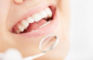 A person at their dental exam.