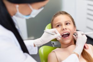 A young patient at her dental appointment.