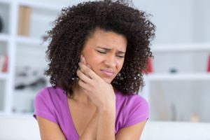 woman with toothache who needs emergency dentist in Hamden