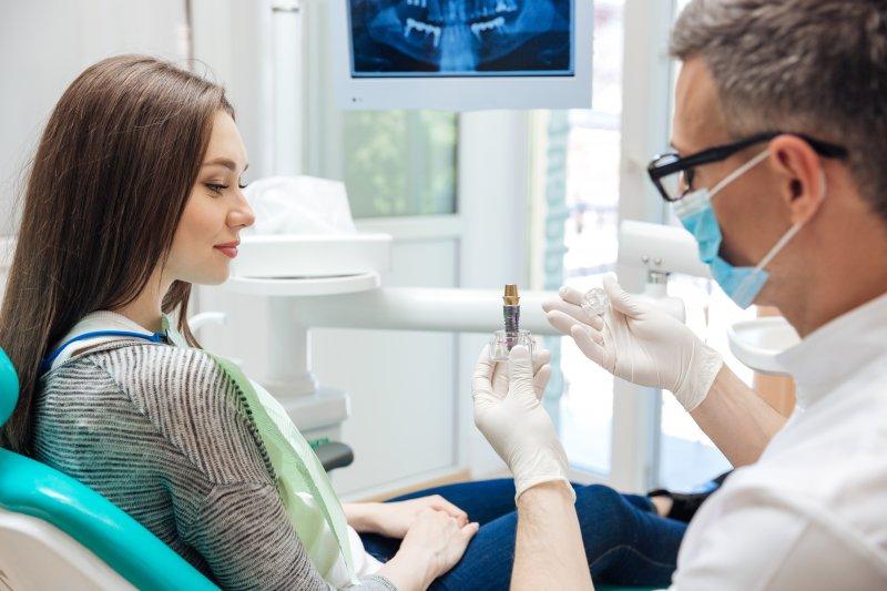 Dentist explaining dental implants in Hamden