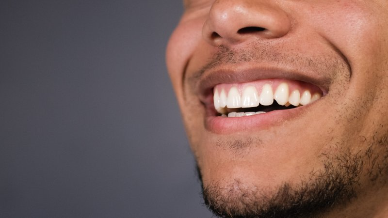 Man smiling after cosmetic dentistry in Hamden