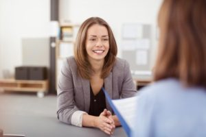 woman with a white smile at a job interview