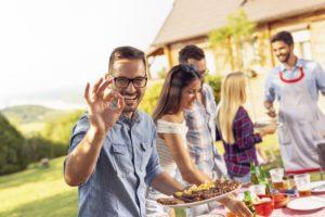 Man with dental implants enjoying summer foods